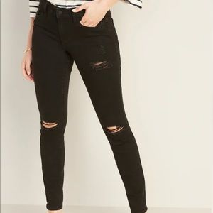black mid-rise distressed pop icon skinny jeans